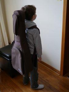 Boy with guitar bag on back
